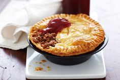 Our reinvention of the the humble meat pie features salty bacon and a fresh thyme.