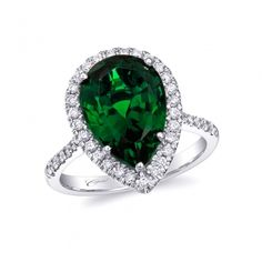 This beautiful ring features a 6.16CT pear-shaped chrome tourmaline accented by a delicate diamond halo.  Set in 14K white gold.
