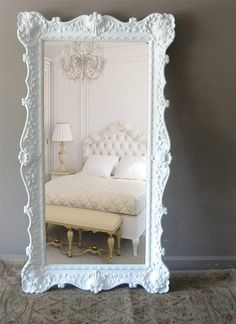A big mirror accent in the boudoir is always a lovely idea!