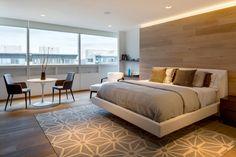 Grande baie vitrée qui baigne de lumière un appartement splendide à Mexico