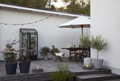 Love the grey decking and planters.