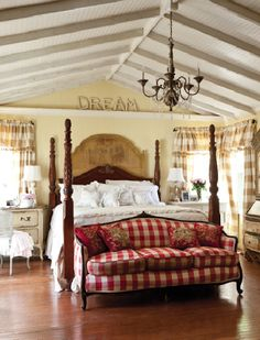 Love this look! This is where I got the idea for the love seat at the end of our bed.
