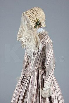 A fine striped taffeta bridal gown and bonnet, circa 1845, of grey and ivory silk with wine foliate stripes,  Whit-this is PERFECT for a beach wedding! ;)
