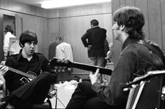 Paul and John warming up backstage in Detroit, Michigan, August 13, 1966.