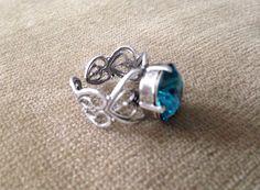 A personal favorite from my Etsy shop https://www.etsy.com/listing/226199371/dainty-beautiful-blue-swarovski-crystal