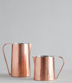 Hammered Copper Pitcher designed by Sfera, a Kyoto based artisan skilled in the ancient metalware craft of tankin who uses his hammer to give a subtle texture to modern copper pots.