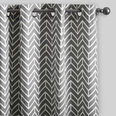 Crafted of soft 100% cotton, our exclusive grommet-top window coverings features off-white chevron arrows zigzagging across a rich charcoal gray background.