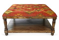 """Baxter Kilim Tufted Coffee Table   Made of: frame, mango wood; upholstery, kilim; fill, foam Size: 45.5""""W x 40.5""""D x 20""""H Color: frame, natural wood; upholstery, red/multi Care: Spot-clean only.  $799.00"""