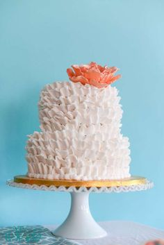 I think this is beautiful. Looks like you use the petal tip and start and top side and layer downward. Love the texture and whimsy of it. Kind of like sea coral.Put a shell or starfish on top.
