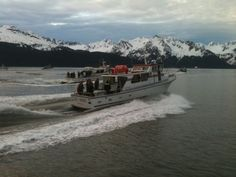 A boat carries servicemen and servicewomen out onto Resurrection Bay, Seward, en route to a fishing outing, in this photo by Lee Leschper.