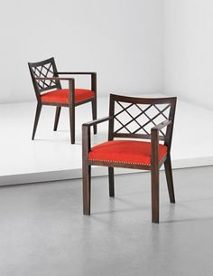 "Jean Royère, Pair of ""Croisillon"" armchairs"