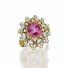PINK SAPPHIRE AND DIAMOND RING, BUCCELLATI The domed openwork floral motif set in the center with a cushion-shaped pink sapphire weighing approximately 3.25 carats, completed by 60 round diamonds weighing approximately 1.25 carats, mounted in 18 karat white and yellow gold, approximately size 51⁄2, signed Buccellati.