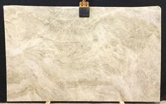 We just received a new bundle of #perlavenata, this #Quartzite is astonishing all by itself. This slab has a base of #beige, and #taupe with hints of white. You can use this piece for any #kitchen #countertop or #island #project.