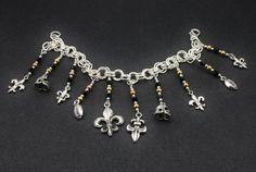Bracelets For Ladies  :    New Orleans SAINTS Inspired charm bracelet with hand beading, Tibetan silver charms of Fleur-de-lis, football, & helmet. GEAUX SAINTS  - #Bracelets  https://talkfashion.net/acceseroris/bracelets/bracelets-for-ladies-new-orleans-saints-inspired-charm-bracelet-with-hand-beading-tibetan-silver-cha/
