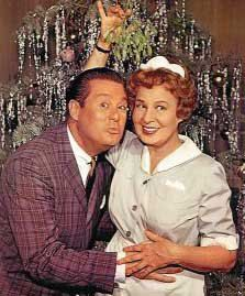 """""""Mr. B and Hazel meet under the mistletoe"""" (Don DeFore and Shirley Booth) posing for publicity shot.  ♺ Kathy H"""