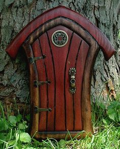A wood door in the garden looks absolutely magical! I would love a life-sized door!!!