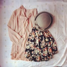 feminine and flowy silk tie front blouse and floral a-line mini with cute hat