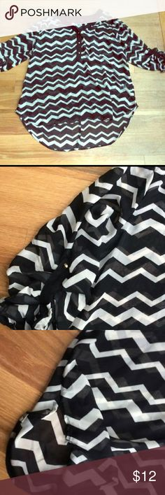 Plus Size Sheer Chevron Print Top Excellent used condition, no flaws that I'm aware of. Smoke and pet free home. Has gold spiked buttons on arm so you can roll up sleeves or keep them long! Plus size 1 which is a 1X. Slits on each sides make it even cuter! No ♏️ or trades. Pure Energy Tops Blouses