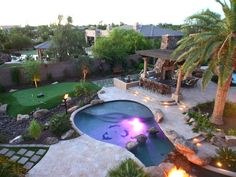 Outdoor kitchen. Five-hole putting green. Pool's waterfalls created by boulders bigger than cadillacs.  Flaming waterfall lighting effects.  Palm trees were brought in by crane. = Multi-million dollar pool.