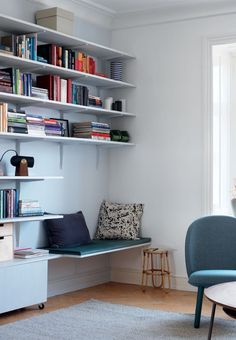 Homemade shelving system with a cozy bench for a personal time-out or reading hour.