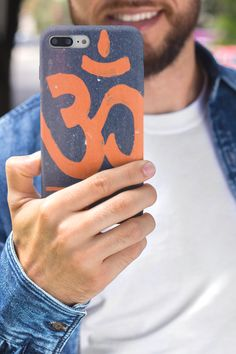 """The sacred sound """"Om"""" takes the same shape as one of the most basic geometric forms in our universe, the ellipse. Its print can make about anything look beautiful. Our Om yoga phone case is available for iPhone and Samsung. Samsung Cases, Iphone Cases, Phone Covers, Ninja, Om, Universe, Motorcycle, Shape, How To Make"""