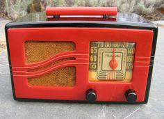An eye-catching red and black vintage Bakelite Motorola radio.