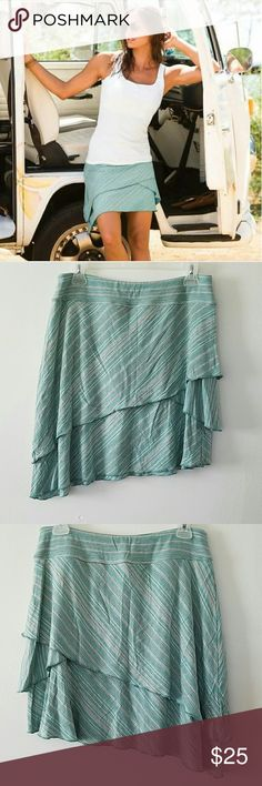 Athleta skirt Beautiful Athleta asymmetrical skirt. Quality knit fabric. Cute for either summer or with tights and boots for fall. Very good condition. Slightly above knee length. Size M. Athleta Skirts