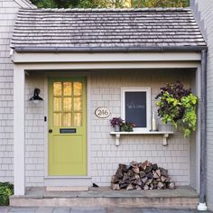 Love this back door with a shelf and a chalkboard. Not so sure about the pile of wood next to the siding however!