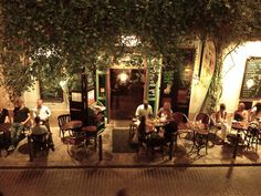 #interior #courtyard  I love the hanging greenery and outside cafe seating!  Perfect for one of the outside patios!