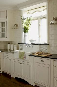 Cooking implements, appliances and storage are also important facets of farmhouse kitchen design. Sinks have a special place in farmhouse kitchen design. The classic farmhouse sink features a deep, wide basin often made of porcelain or stainless steel; Farmhouse Kitchen Cabinets, Modern Farmhouse Kitchens, Kitchen Redo, Home Kitchens, Kitchen Ideas, Farmhouse Sinks, White Farmhouse, Farmhouse Style, Kitchen White