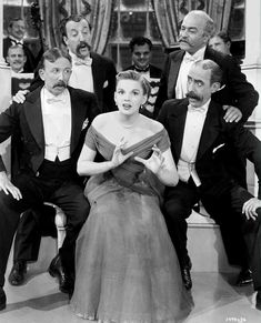 "In the Good Old Summertime (1949)  Full shot of Judy Garland as Veronica Fisher/Larken singing ""Play That Barbershop Chord."" with quartet."