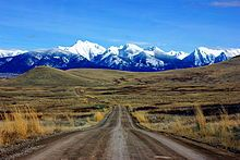 road through the National Bison Range in MT...I must go to this place and photograph those snowy mountains in sunrise and sunset
