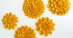I fell in love with these felt flowers I saw on Pinterest so I made some of my own. Here is how... They were so easy...now what to do wi...
