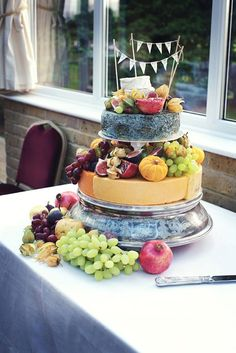 Marks and Spencer Cheese wedding cake / http://www.deerpearlflowers.com/rustic-wedding-cakes-tend-cheese-wedding-cakes/