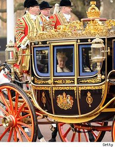 Queen Elizabeth driving by in her carriage