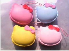 light pink , yellow, pink, and blue hk macaroon squishies.