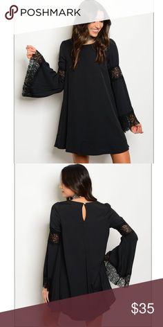 Women's Black Lace Long Bell Sleeve Party Dress You're looking at a beautiful black long bell sleeve dress! Brand new still in package. This dress does come with tags. Can be worn for any occasion just add shoes if your liking (heels, boots, sandals)  Long Bell Sleeve with Lace in the middle and around the bottom of the sleeve. Flirty yet elegant Keyhole back with Button closure Size: Medium Brand: Blush Noir Made in the USA Blush Noir  Dresses Long Sleeve