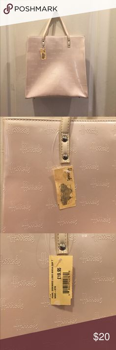 Harrods Ivory tote purse Cute NWT tote purse from Harrods. £19.95 in euros. Great for everyday wear. Never worn or used Harrods Bags Totes