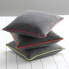 A simple but striking cushion with a contrasingt piped edge designed by Catherine Colebrook. £33.00