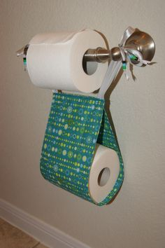 Omg I'm so doing this!! No more rolls on the window sill in the bathroom!!