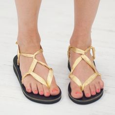 Gold Shimmer Sandals. I live in two pairs of sandals all summer: one silver, one gold. These Sseko Ribbon sandals are produced in Uganda from locally-sourced materials. When you purchase them, you help young women in Uganda attend University and stop the cycle of poverty.