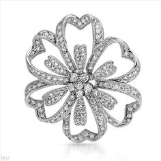 $829.00  Terrific Brand New Pendant With 1.28ctw Genuine  Clean Diamonds Beautifully Crafted in 18K White Gold. Total item weight 5.2g  Length 33.5mm - Certificate Available.