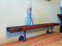 Reclaimed Cedar Shelf with Black Pipe supports
