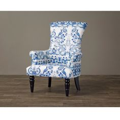 Contrasting leg designs and a vivid flower-and-bird print distinguish this contemporary arm chair. The hardwood-and-plywood construction and comfortable foam cushioning make this arm chair a great addition to your home.
