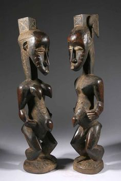 Africa | Statues from the Gouro/Guro people of the Ivory Coast. | Carved wood