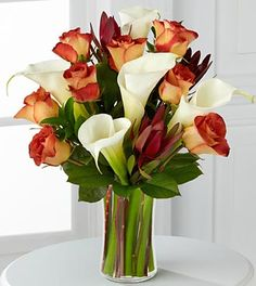 Love these ginger spice Leonidas roses with Calla Lillies like mom had in her wedding bouquet :)