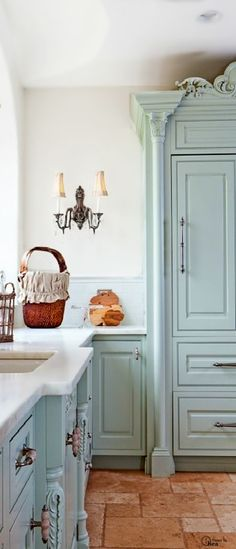 Love love love the washed blue color kitchen with terracota floors.