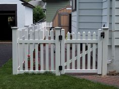 Vinyl picket fence to keep the critters out. Low maintenance.