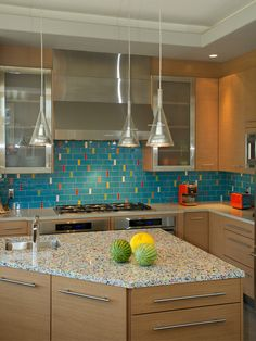 Rainbow recycled glass countertop with turquoise backsplash