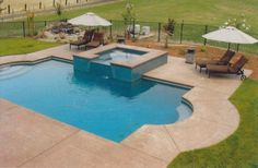 This decorative concrete stamped pool deck that was colored with Davis Colors San Diego Buff (www.daviscolors.com). For the stamped portion they used an Roman Slate patterned stamp with a nutmeg colored release agent. The Concrete Contractor was Kolstads Custom Concrete - 916-660-9157. The ready mix supplier was Folsom Ready Mix - 916-355-0300 - www.folsomreadymix.com.